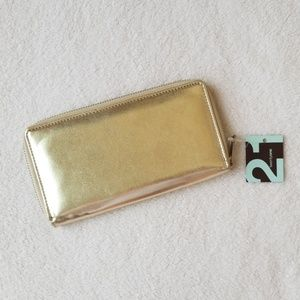 FREE with a purchase from my closet. Gold wallet